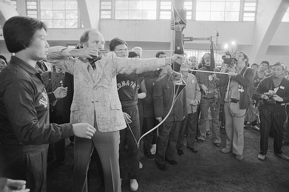 Canadian prime minister Pierre Elliott Trudeau tries to hit the mark in archery at the Institute of Physical Culture in Beijing, China, on Oct. 11, 1973. Bettmann/Getty Images