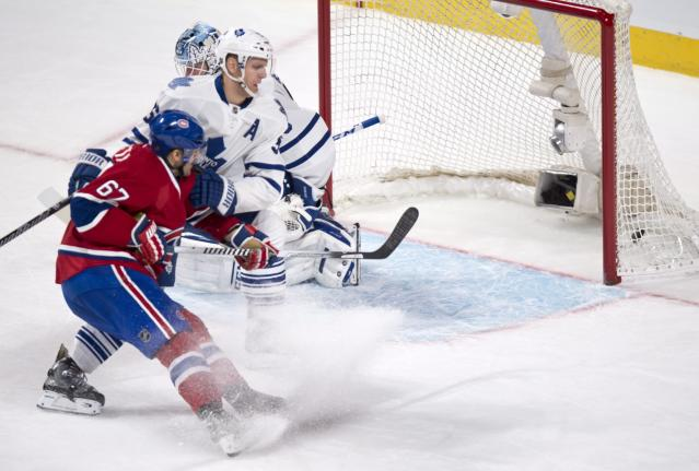 Montreal Canadiens' Max Pacioretty scores a short-handed goal past Toronto Maple Leafs goalie Jonathan Bernier and defenseman Carl Gunnarsson during the second period of an NHL hockey game Saturday, Nov. 30, 2013 in Montreal. (AP Photo/The Canadian Press, Paul Chiasson)