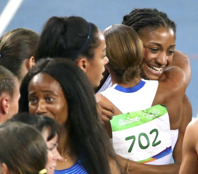 2016 Rio Olympics - Athletics - Final - Women's Heptathlon 800m - Olympic Stadium - Rio de Janeiro, Brazil - 13/08/2016. Jessica Ennis-Hill (GBR) of Britain congratulates Nafissatou Thiam (BEL) of Belgium after the race REUTERS/David Gray FOR EDITORIAL USE ONLY. NOT FOR SALE FOR MARKETING OR ADVERTISING CAMPAIGNS.