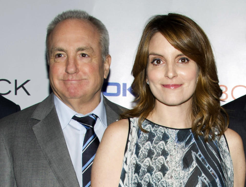 """FILE - In this Dec. 20, 2013 file photo, Lorne Michaels, left, and Tina Fey attend the """"30 Rock"""" farewell wrap party in New York. Fey will host the season opener of """"Saturday Night Live,"""" on Sept. 28. (Photo by Charles Sykes/Invision/AP, File)"""