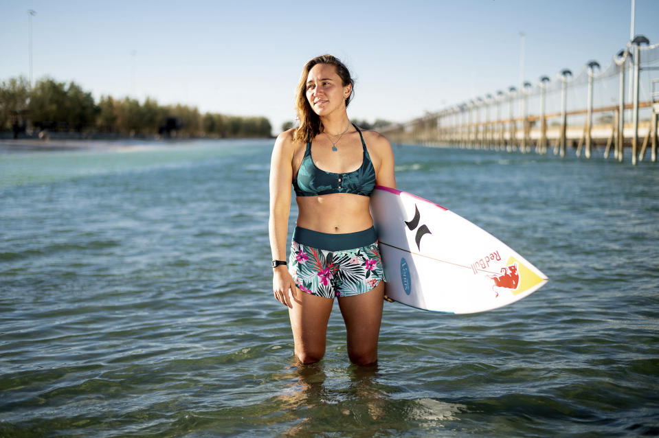 Carissa Moore stands for a portrait at Surf Ranch after practicing for a World Surf League competition on Tuesday, June 15, 2021, in Lemoore, Calif. Moore is headed to the Olympics for surfing's debut at the Games, Though there's much excitement and renewed enthusiasm for the women's game, the objectification, pay disparities and opportunity gap have taken its toll. Industry leaders say they're committed to righting the wrongs that have long held female surfers back in the male-dominated sport. The mental, financial and logistical roadblocks for women in surfing date back centuries.(AP Photo/Noah Berger)