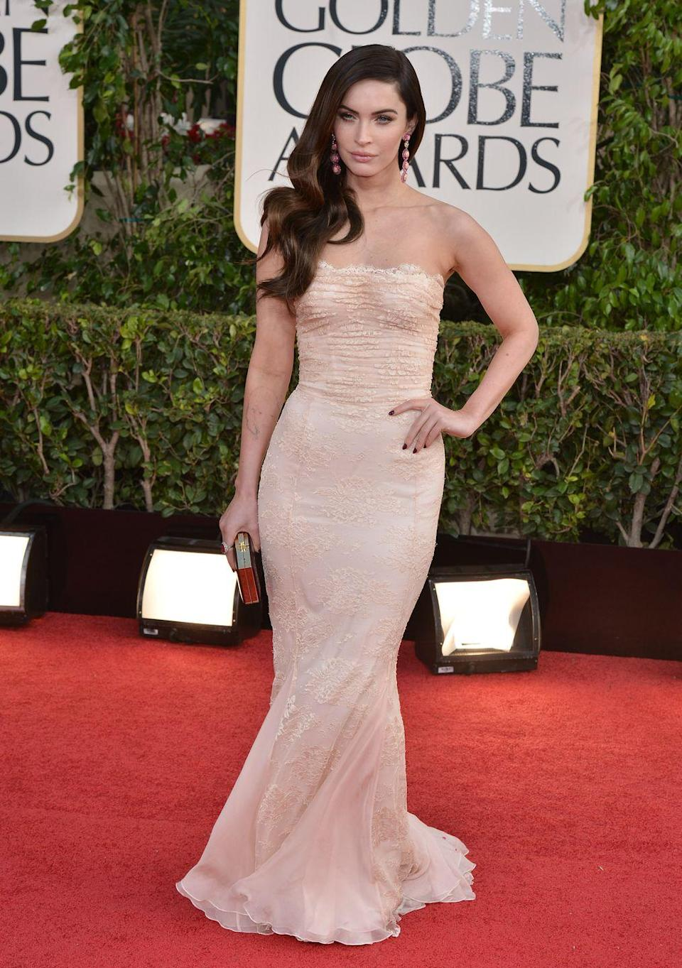 <p>The star wore a strapless ivory-coloured fishtail dress by Dolce & Gabbana to the event. </p>