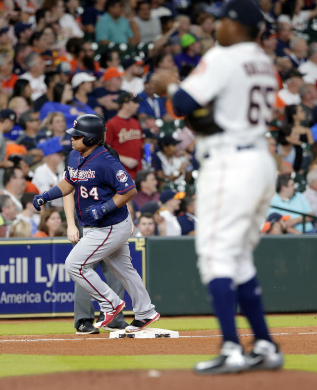 Minnesota Twins designated hitter Willians Astudillo (64) rounds third base after hitting a home run off Houston Astros starting pitcher Framber Valdez (65) during the fifth inning of a baseball game Wednesday Sept. 5, 2018, in Houston. (AP Photo/Michael Wyke)