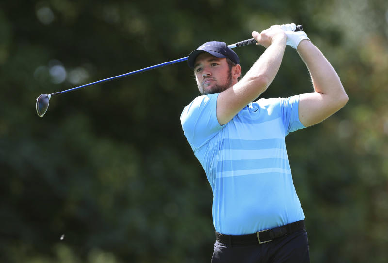 England's Sam Horsfield tees off on the 10th hole, during day four of the Hero Open, in Birmingham, England, Sunday, Aug. 2, 2020. Horsfield shot a final round 4-under 68 to win the Hero Open by one stroke Sunday in the European Tour's latest stop in England. The 23-year-old Englishman clinched his first European Tour title with an 18-under 270 total, holding off second-place Thomas Detry, whose 6-under 66 had briefly given him a share of the lead. (Mike Egerton/PA via AP)