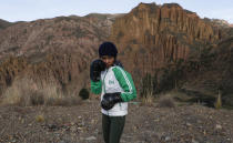 Gracce Kelly Flores, a 12-year-old boxer who goes by the nickname Hands of Stone, poses for a photo as she trains under the coaching of her father in Palca, Bolivia, early Thursday, June 10, 2021, amid the COVID-19 pandemic. At age 8, Flores defeated a 10-year-old boy, and with three national boxing medals under her belt, she dreams of reaching the women's boxing world championship. (AP Photo/Juan Karita)