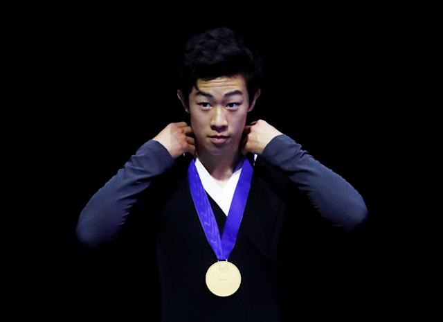 Figure Skating - World Figure Skating Championships - The Mediolanum Forum, Milan, Italy - March 24, 2018 Nathan Chen of the U.S. poses with the gold medal after the Men's Free Skating REUTERS/Alessandro Garofalo