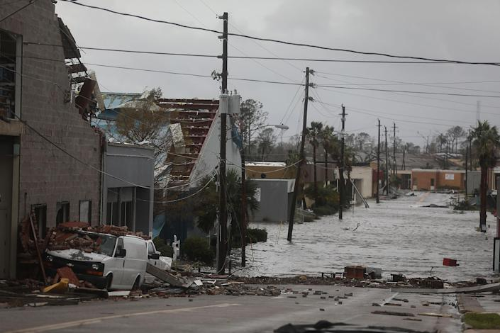 <p>Damaged buildings and a flooded street are seen after hurricane Michael passed through the downtown area on Oct. 10, 2018 in Panama City, Fla. (Photo: Joe Raedle/Getty Images) </p>