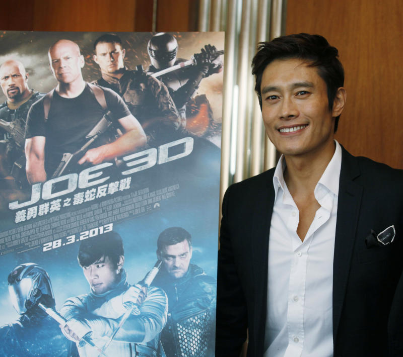 "FILE - In this  Dec. 12, 2012 file photo, South Korea actor Lee Byung-hun poses for photographers after an interview for his latest film ""G.I. Joe: Retaliation"" in Hong Kong. Lee says he had to train hard to do justice to his character in ""G.I. Joe: Retaliation."" The upcoming sequel to ""G.I. Joe: The Rise of Cobra"" has Storm Shadow rising from the dead and out for vengeance. And it required the South Korean actor develop a stronger build. (AP Photo/Kin Cheung, File)"