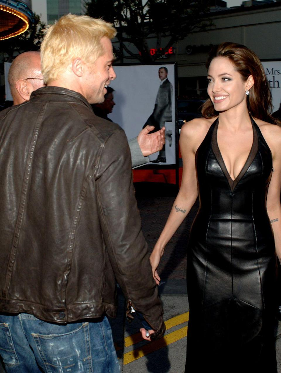 <p>The actors were careful not to get too close on the red carpet at the Los Angeles premiere of <em>Mr. and Mrs. Smith</em> in June 2005 as well. Still, the then-secret couple weren't fooling anyone.</p>