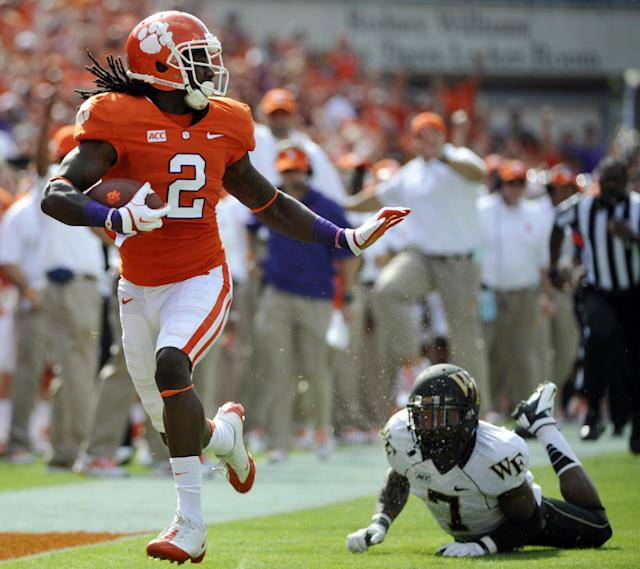 FILE - In this Sept. 28, 2013 file photo, Clemson wide receiver Sammy Watkins (2) runs for a touchdown after making a catch as Wake Forest cornerback Merrill Noel (7) defends during the first half of an NCAA college football game, in Clemson, S.C. Watkins is the latest Florida high school standout to make an impact outside the state. He and the third-ranked Tigers take on No. 5 Florida State on Saturday night. (AP Photo/Rainier Ehrhardt, File)