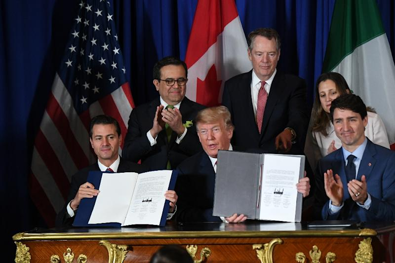 Mexico's President Enrique Pena Nieto (L) US President Donald Trump (C) and Canadian Prime Minister Justin Trudeau, are pictured in November 2018 after signing a new free trade agreement in Buenos Aires (AFP Photo/Martin BERNETTI)