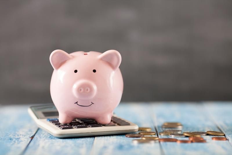 Piggy bank with calculator. (Photo: Shutterstock)