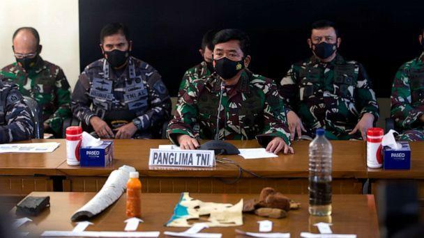 PHOTO: Indonesian Military chief Hadi Tjahjanto, center, talks to media as they display debris found in the waters during a search for The Indonesian Navy submarine KRI Nanggala at Ngurah Rai Military Air Base in Bali, Indonesia on Saturday, April 24. (Firdia Lisnawati/AP)