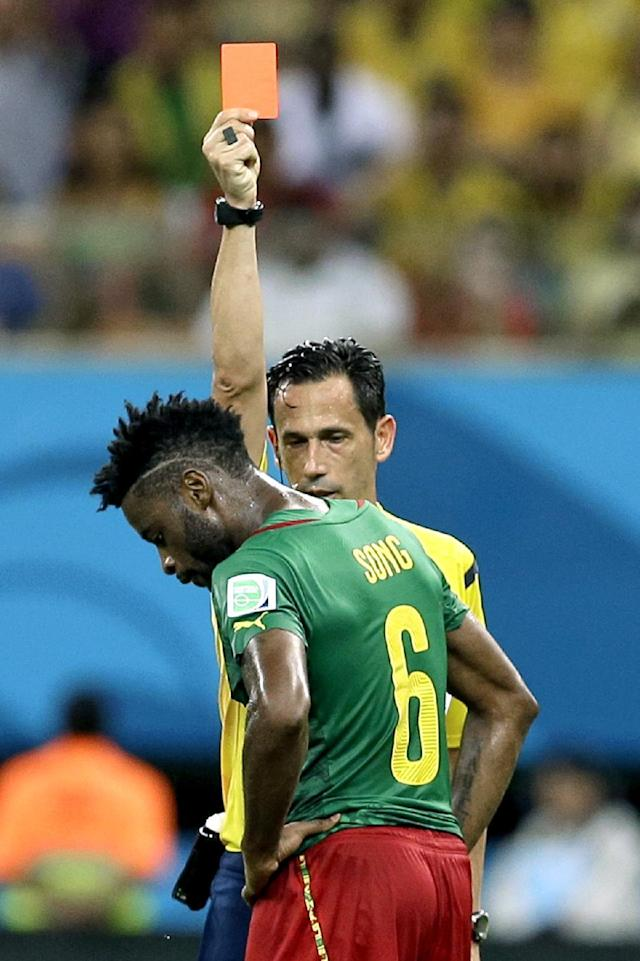 Referee Pedro Proenca from Portugal gives a red card to Cameroon's Alex Song during the group A World Cup soccer match between Cameroon and Croatia at the Arena da Amazonia in Manaus, Brazil, Wednesday, June 18, 2014. (AP Photo/Themba Hadebe)