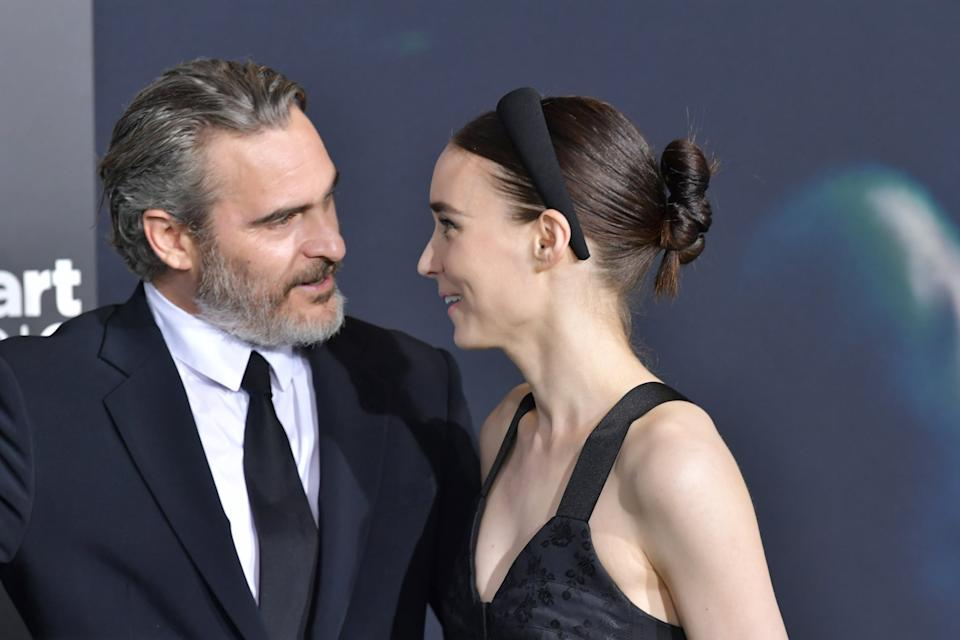 HOLLYWOOD, CALIFORNIA - SEPTEMBER 28: Joaquin Phoenix and   Rooney Mara attend the premiere of Warner Bros Pictures