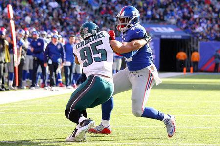 Jan 3, 2016; East Rutherford, NJ, USA; New York Giants tight end Will Tye (45) carries the ball to score a touchdown as Philadelphia Eagles linebacker Mychal Kendricks (95) attempts to tackle during the second quarter at MetLife Stadium. Mandatory Credit: Brad Penner-USA TODAY Sports / Reuters Picture Supplied by Action Images