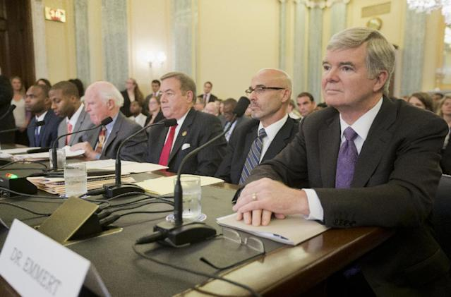 National Collegiate Athletic Association (NCAA) President Mark Emmert, right, waits to testify on Capitol Hill in Washington, Wednesday, July 9, 2014, before the Senate Commerce hearing on the NCAA's treatment of athletes. From left are, Myron Laurent Rolle, student Florida State College of Medicine, former college football player, Florida State, Devon Jahmai Ramsay, former college football player, University of North Carolina, Taylor Branch, author and historian, William Bradshaw, former Athletic Director, Temple University, Dr. Richard M. Southall, Associate Professor, Department of Sport and Entertainment Management, and Emmert. (AP Photo/Pablo Martinez Monsivais)