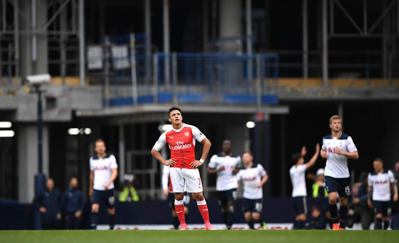 Alexis Sanchez of Arsenal looks dejected after Tottenham Hotspur first goal during the Premier League match between Tottenham Hotspur and Arsenal at White Hart Lane