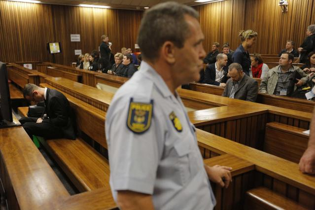 Olympic and Paralympic track star Oscar Pistorius sits in the dock during court proceedings at the North Gauteng High Court in Pretoria March 14, 2014. Pistorius is on trial for murdering his girlfriend Reeva Steenkamp at his suburban Pretoria home on Valentine's Day last year. REUTERS/Kim Ludbrook/Pool (SOUTH AFRICA - Tags: SPORT CRIME LAW ATHLETICS)