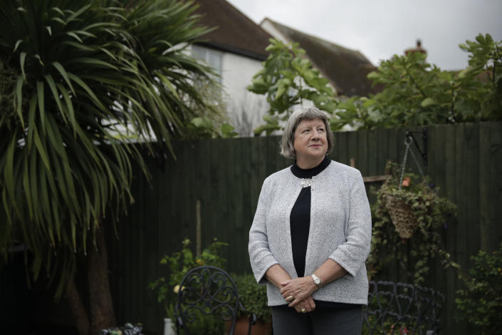 """Mayflower descendant Vicky Cosstick poses for a portrait in the back garden of her home in the town of Seaford, on the south coast of England, Friday, Oct. 2, 2020. Cosstick said she's troubled by the suffering the indigenous people endured, but she doesn't feel guilt. """"I'm of course horrified and appalled to know what happened as a result of British colonialism in America and what happened to their Native American tribes and the Wampanoags,"""" Cosstick said. """"It's not as if they went to America in order to steal land from an indigenous population,"""" she said. """"Much of it was clearly wrong, but there are many stories that need to be told. And I think the anniversary gives a chance for all of those stories to be told."""" (AP Photo/Matt Dunham)"""