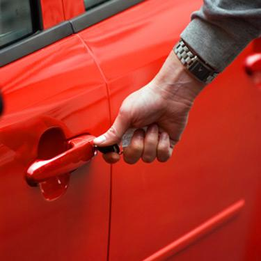 Hand-on-new-red-car_web