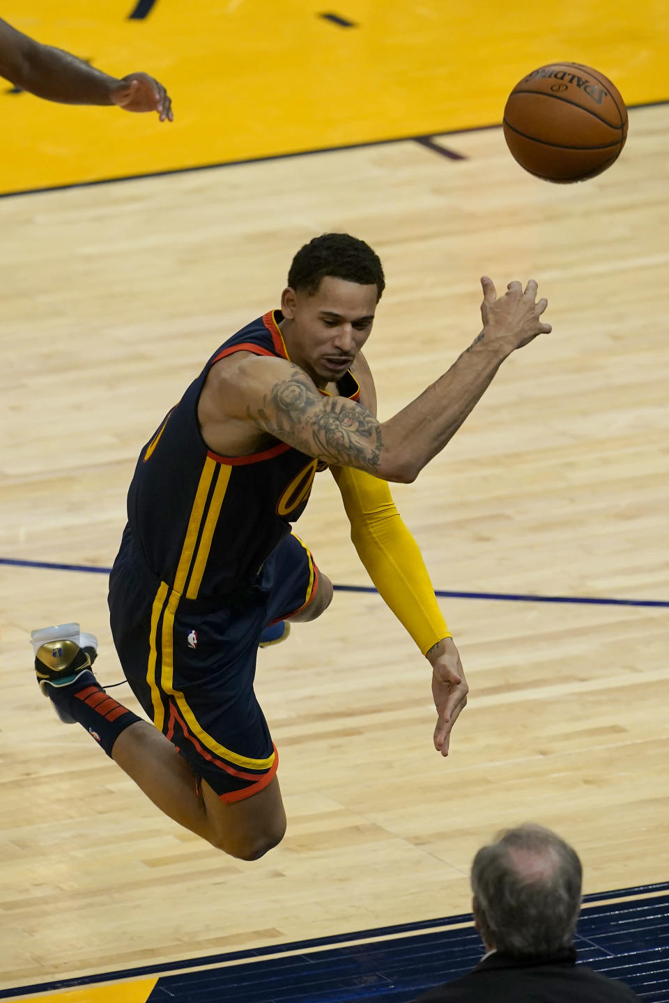 Golden State Warriors forward Juan Toscano-Anderson saves a ball from going out of bounds during the second half of an NBA basketball game against the Oklahoma City Thunder in San Francisco, Thursday, May 6, 2021. (AP Photo/Jeff Chiu)