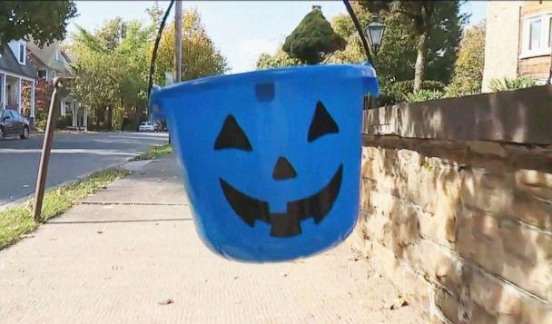 PHOTO: Blue buckets will be carried this Halloween for autism awareness. (WNEP)