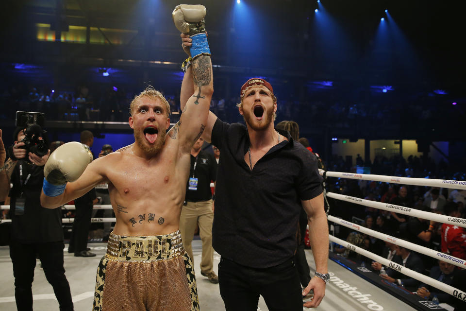 Jake Paul (pictured left) celebrates with his brother, Logan (pictured right), after defeating AnEsonGib in a first round knockout during their fight at Meridian at Island Gardens on January 30, 2020 in Miami, Florida.