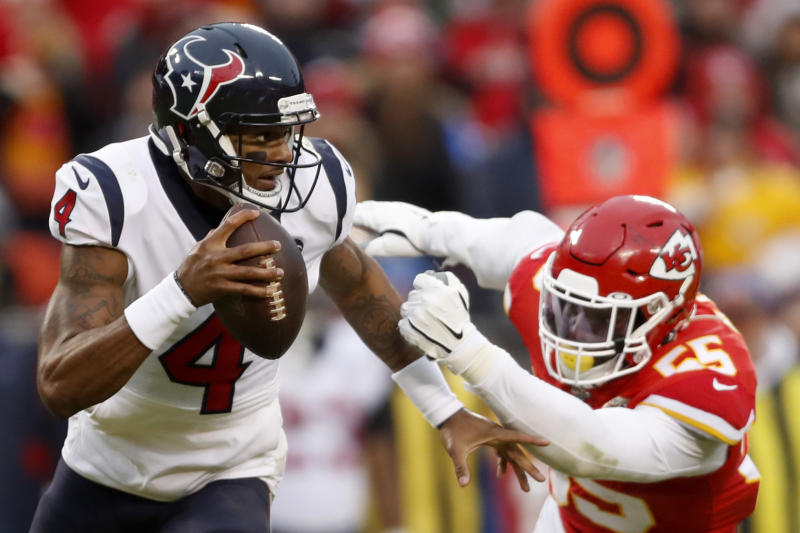 Houston Texans quarterback Deshaun Watson (4) scrambles under pressure from Kansas City Chiefs defensive end Frank Clark (55) during the second half of an NFL divisional playoff football game, in Kansas City, Mo., Sunday, Jan. 12, 2020. (AP Photo/Jeff Roberson)