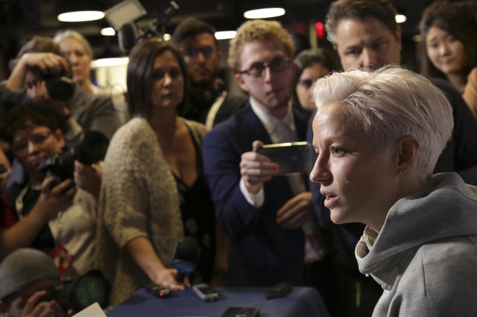 FILE - In this May 24, 2019, file photo, Megan Rapinoe, a member of the United States women's national soccer team, speaks to reporters during a media day in New York. While the Americans make their way around France for the month-long Women's World Cup, back at home they're all part of a lawsuit that accuses U.S. Soccer of gender discrimination. (AP Photo/Seth Wenig, File)