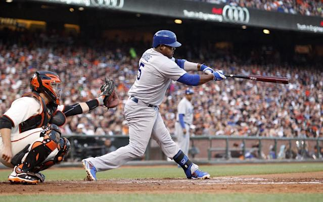 Los Angeles Dodgers' Juan Uribe hits an RBI double during the sixth inning of a baseball game against the San Francisco Giants, Saturday, July 26, 2014, in San Francisco. (AP Photo/Beck Diefenbach)