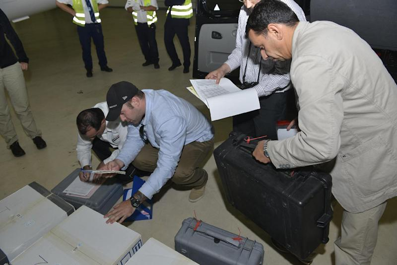 "FILE - In this file photo released Saturday Aug. 31, 2013 by the Organization for the Prohibition of Chemical Weapons, samples brought back by the U.N. chemical weapons inspection team are checked in upon their arrival at The Hague, Netherlands. Syria has sent the Organization for the Prohibition of Chemical Weapons an ""initial declaration"" outlining its weapons program, the organization said Friday Sept. 20, 2013. (AP Photo/OPCW, Henry Arvidsson, File)"