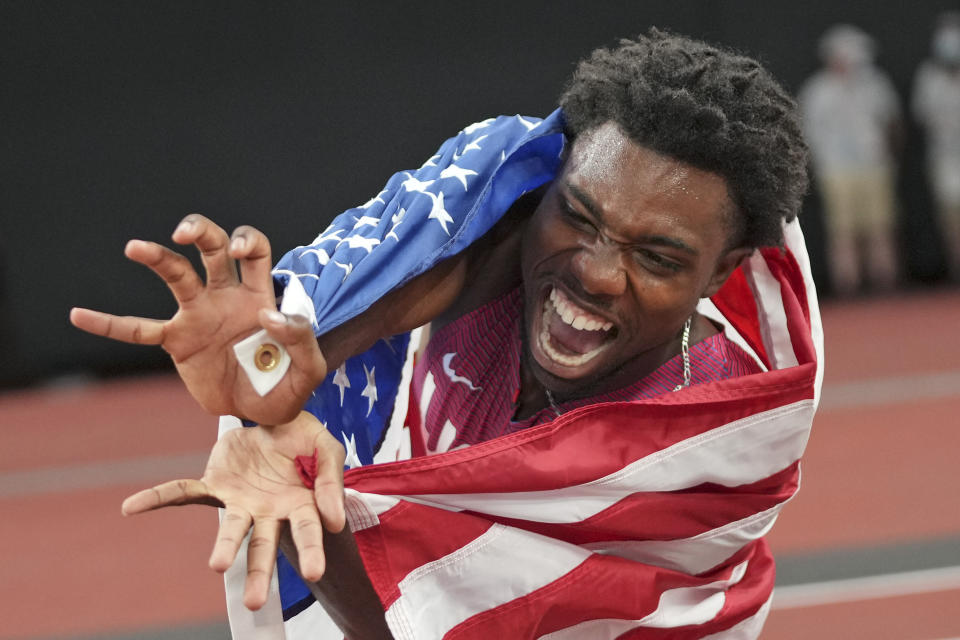 <p>Kenneth Bednarek, of United States, celebrates after his second place finish in the final of the men's 200-meters at the 2020 Summer Olympics, Wednesday, Aug. 4, 2021, in Tokyo. (AP Photo/Matthias Schrader)</p>