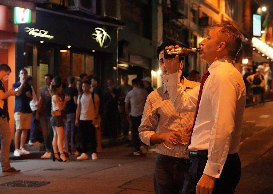 Punters enjoy a drink in Central following the launch of Hong Kong's 'vaccine bubble'. Photo: Felix Wong