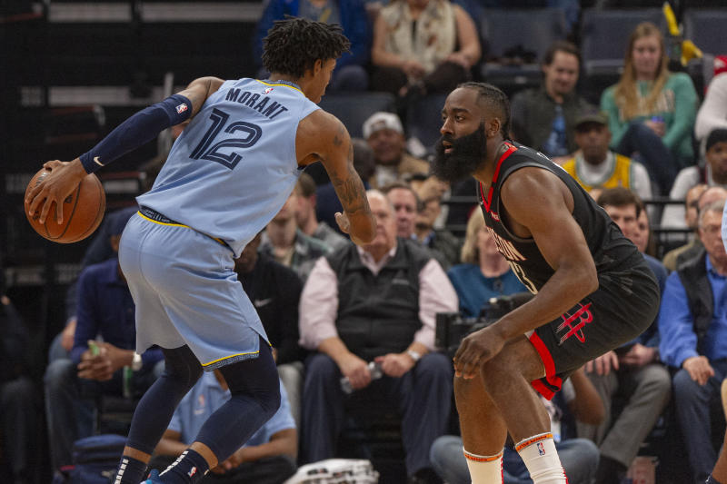 Jan 14, 2020; Memphis, Tennessee, USA; Memphis Grizzlies guard Ja Morant (12) handles the ball against Houston Rockets guard James Harden (13) during the first half at FedExForum. Mandatory Credit: Justin Ford-USA TODAY Sports