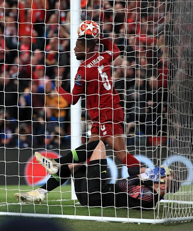 Liverpool's Georginio Wijnaldum tries to retrieve the ball from Barcelona's Marc-Andre ter Stegen after scoring his sides second goal during the UEFA Champions League Semi Final, second leg match at Anfield, Liverpool. (Photo by Peter Byrne/PA Images via Getty Images)