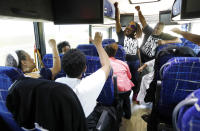 FILE - In this Aug. 24, 2018, file photo, Black Voters Matter Fund co-founders, LaTosha Brown, left, and Cliff Albright, right, lead Mississippi grassroots partners in some empowerment cheers aboard a bus tour to Greenville, Miss. Thousands of Black activists from across the U.S. will hold a virtual convention on Aug. 28, 2020, to produce a new political agenda that builds on the protests that followed George Floyd's death. Albright, said the 2020 Black National Convention will deepen the solutions to systemic racism and create more alignment within the movement. (AP Photo/Rogelio V. Solis)