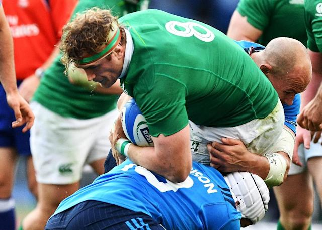 "Ireland's Jamie Heaslip (C) will be out for a number of weeks after undergoing a ""minor procedure"" on his lower back (AFP Photo/Vincenzo PINTO)"