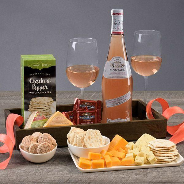 """<p><strong>Product ID:</strong></p><p>gourmetgiftbaskets.com</p><p><strong>$69.99</strong></p><p><a href=""""https://go.redirectingat.com?id=74968X1596630&url=https%3A%2F%2Fwww.gourmetgiftbaskets.com%2FRose-All-Day-Gift-Crate.asp&sref=https%3A%2F%2Fwww.townandcountrymag.com%2Fleisure%2Fdining%2Fg29328884%2Fbest-wine-cheese-gift-baskets%2F"""" rel=""""nofollow noopener"""" target=""""_blank"""" data-ylk=""""slk:Shop Now"""" class=""""link rapid-noclick-resp"""">Shop Now</a></p><p>What could please a rosé lover more than a gift basket packed with, of course, a bottle of delectable pink wine as well as cheddar, garlic cheddar, and crackers, plus sweet nibbles like dark chocolate squares and cinnamon cookies. </p>"""
