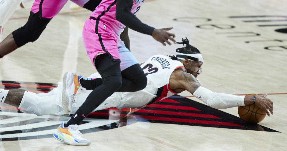 Portland Trail Blazers forward Robert Covington dives for thee ball against the Miami Heat during the second half of an NBA basketball game in Portland, Ore., Sunday, April 11, 2021. (AP Photo/Craig Mitchelldyer)