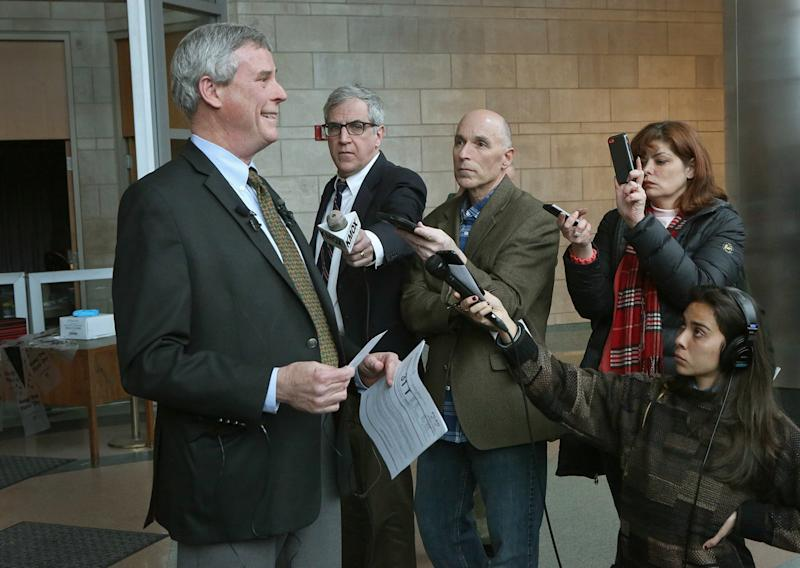 St. Louis Prosecuting Attorney Robert McCulloch, left, speaks during a press conference on Monday, March 13, 2017, at the St. Louis County Justice Center to address the latest video just released that shows Michael Brown at the Ferguson Market the night before he was shot. McCulloch was critical Monday of surveillance video from a new documentary about the Michael Brown shooting in Ferguson, Missouri, calling it a heavily-edited attempt to distort an incident that occurred several hours before Brown died in an encounter with a police officer.  (J.B. Forbes/St. Louis Post-Dispatch via AP)