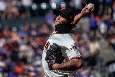 Jul 11, 2018; San Francisco, CA, USA; San Francisco Giants starting pitcher Dereck Rodriguez (57) pitches against the Chicago Cubs during the eleventh inning at AT&T Park. Mandatory Credit: Stan Szeto-USA TODAY Sports