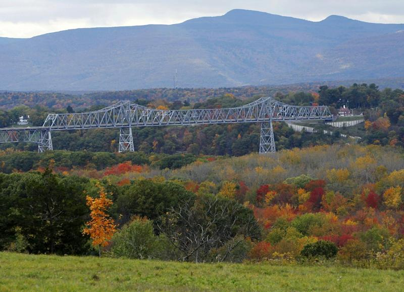 FILE - This Oct. 19, 2010 file photo shows the Rip Van Winkle Bridge, which spans the Hudson River amid autumn colors in Greenport, N.Y. The Hudson Valley region offers many free things to see and do, including beautiful scenery from the river and surrounding mountains and towns. (AP Photo/Mike Groll, File)