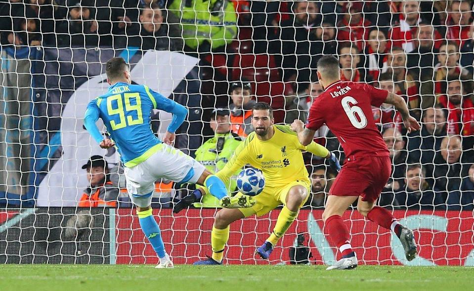 Alisson Becker (center, in yellow) made a spectacular stoppage-time save to keep Liverpool alive in the Champions League.