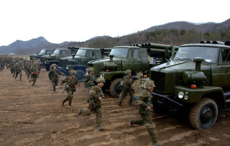 North Korean soldiers run as they attend military training in an undisclosed location. REUTERS/KCNA