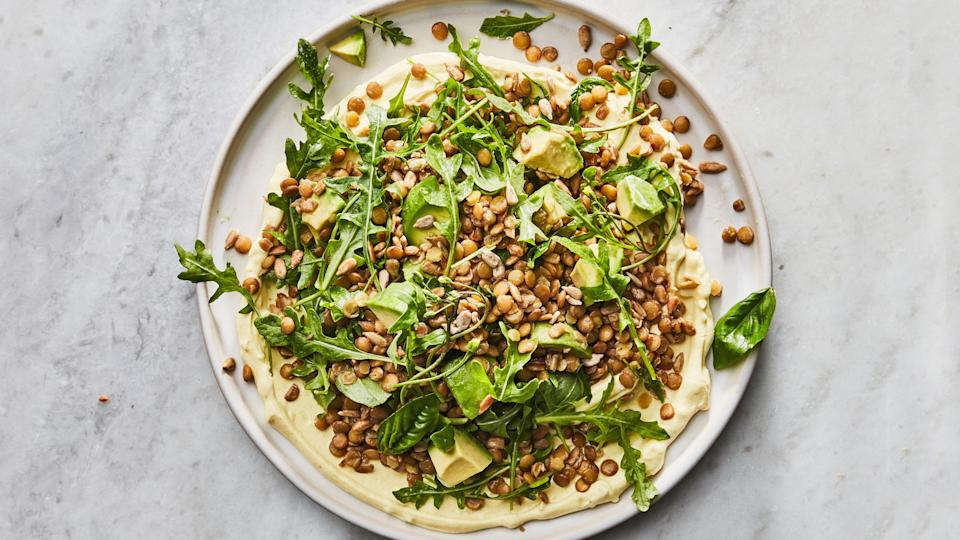 "Cool yogurt, crunchy seeds, and avocado turn lentils into a lunch salad you'll actually be excited to eat. Serve it with warm pita for swiping up the garlicky yogurt. We have Heidi Swanson, the <a href=""https://www.amazon.com/Heidi-Swanson/e/B001JS2UWI"" rel=""nofollow noopener"" target=""_blank"" data-ylk=""slk:vegetarian cookbook author"" class=""link rapid-noclick-resp"">vegetarian cookbook author</a> and blogger behind <a href=""https://www.101cookbooks.com/"" rel=""nofollow noopener"" target=""_blank"" data-ylk=""slk:101 Cookbooks"" class=""link rapid-noclick-resp""><em>101 Cookbooks</em></a>, to thank for this lightning-fast weeknight dinner recipe. <a href=""https://www.bonappetit.com/recipe/big-green-lentil-salad?mbid=synd_yahoo_rss"" rel=""nofollow noopener"" target=""_blank"" data-ylk=""slk:See recipe."" class=""link rapid-noclick-resp"">See recipe.</a>"