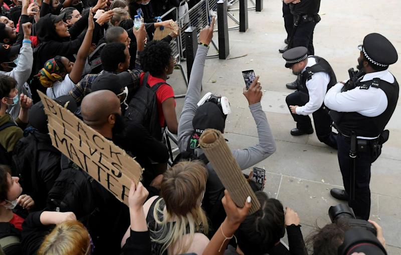 Some police officers spontaneously took the knee in front of protesters near Downing Street during a Black Lives Matter protest following the death of George Floyd. (Reuters)