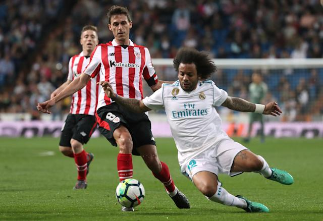 Soccer Football - La Liga Santander - Real Madrid vs Athletic Bilbao - Santiago Bernabeu, Madrid, Spain - April 18, 2018 Real Madrid's Marcelo in action with Athletic Bilbao's Ander Iturraspe REUTERS/Susana Vera