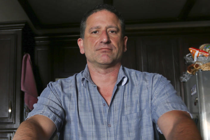 FILE - In this March 24, 2016, file photo, Keith Gartenlaub is seen at his home in Southern California. The Justice Department's internal watchdog is reviewing the former Boeing engineer's allegations that he was unfairly pursued by FBI agents who investigated him on suspicions that he was spying for China. (AP Photo/Lenny Ignelzi, File)