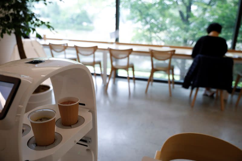 A robot that takes orders, makes coffee and brings the drinks straight to customers is seen in a cafe in Daejeon